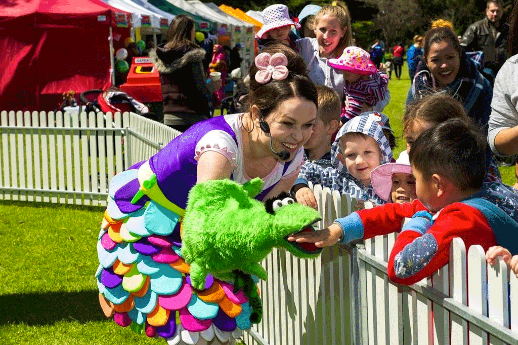 image of Tulip and Chomper with kids after a show