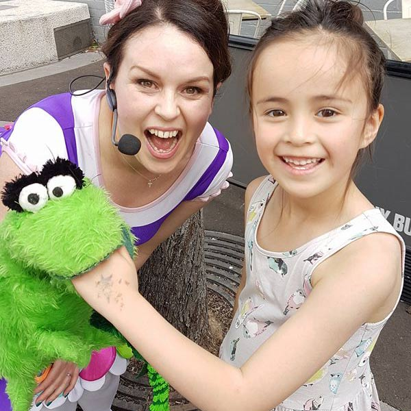 image of Tulip and Chomper with a girl at a kids party